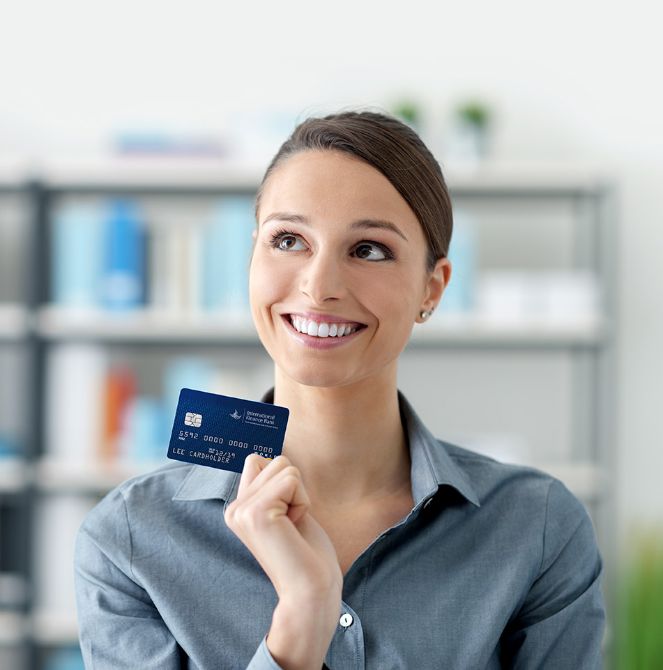 Smiling woman holding IFB Mastercard