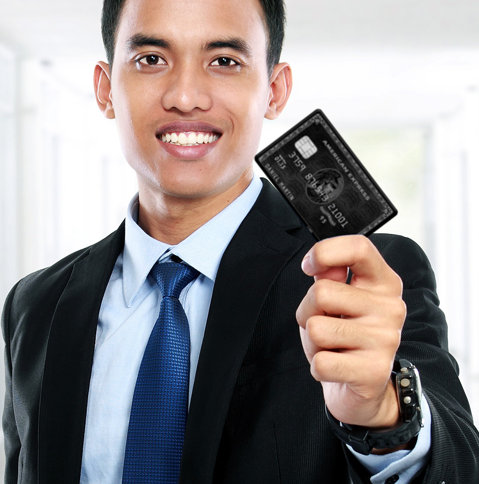 Smiling man holding American Express card